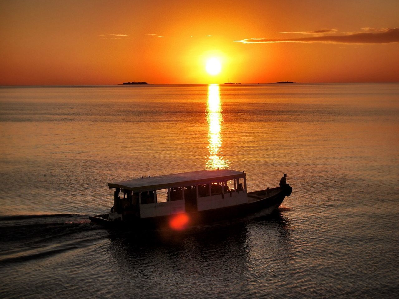High Angle View Of Boat Moving On Sea Against Sky During Sunset