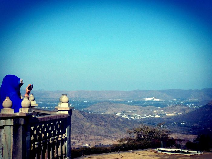 Blue Railing Sky Scenics Outdoors Tranquility Water Nature Beauty In Nature One Person People Adults Only Day Roadtrip Fort Fort Udaipur Mobile Conversations