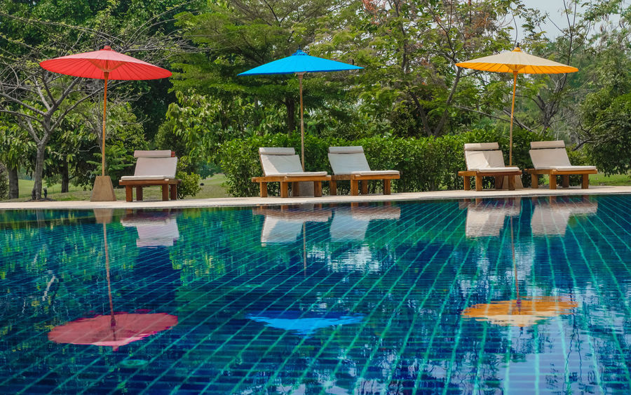 Absence Abundance Arrangement Blue Chiangmai Thailand Empty Green Green Color Growth Multi Colored Nature No People Outdoors Plant Resort Hotel Seat Side By Side Tree