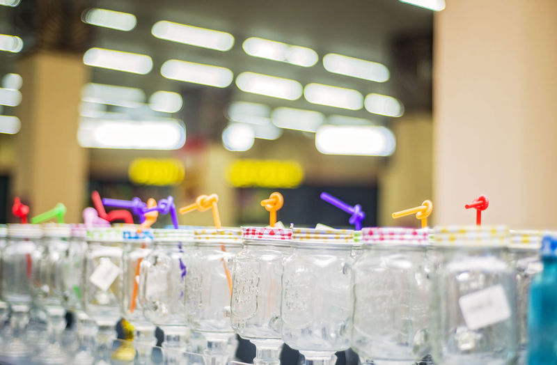 In A Row Indoors  Still Life Close-up Focus On Foreground Freshness No People Supermarket Illuminated Flame Burning Event Fire Glass Table Celebration Empty Container Liquid Container Glass - Material Variation Shopping Choice Retail Display Store My Best Photo