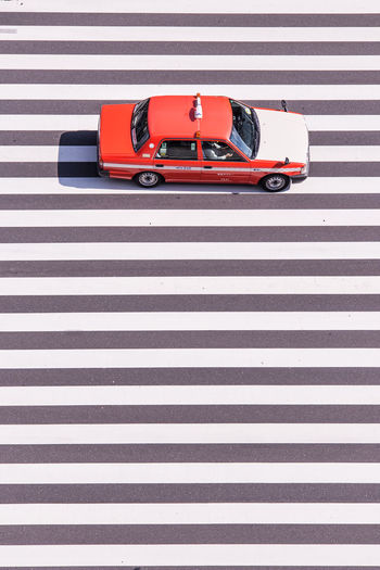High angle view of taxi on zebra crossing