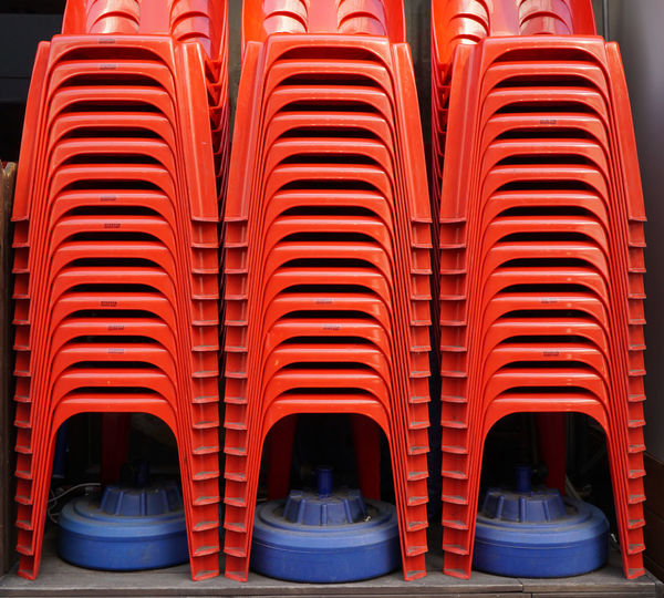 stacked red chairs in seoul, south korea Abstract Architectural Feature Architecture Benches Built Structure Chair Close-up Color Design Geometric Shape In A Row Indoors  Red Red Lips Repetition Seoul Stacked Stacked Chairs Vibrant Color
