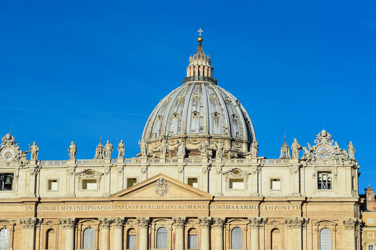 High Section Of St Peter Basilica Church Against Clear Blue Sky