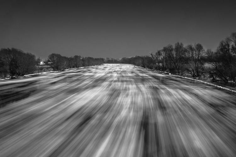 Long exposure shot of ice floe on Warta river Ice Floe ND Filter River View Winter Blakck And White Blurred Motion Cold Temperature Ice Covered  Long Exposure Motion Nature Outdoors Riverscape Snow Speed Time Transportation Tree Winter