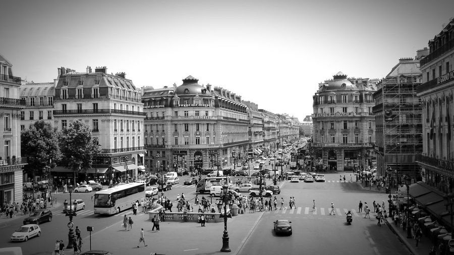 B&w Street Photography Place De L'opéra Paris Paris, France  Streetphotography Streetphoto_bw Perspective Urban Geometry Urban Landscape Avenue B&w Photography Architecture Architecture_bw Battle Of The Cities