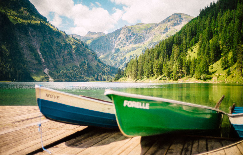 VSCO Beauty In Nature Boat Close-up Day Elmarit Lake Leica Mode Of Transport Moored Mountain Mountain Range Nature Nautical Vessel No People Outdoors Scenics Sky Tranquility Transportation Tree Water Wood - Material Been There. Go Higher The Traveler - 2018 EyeEm Awards