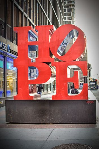 Art Sculpture Sculpture Hope Hope Sculpture Architecture Built Structure City Building Exterior Street Red No People Wall - Building Feature Western Script City Life