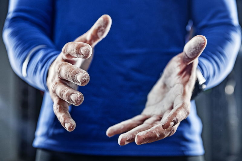 Midsection of man with talcum powder clapping hands