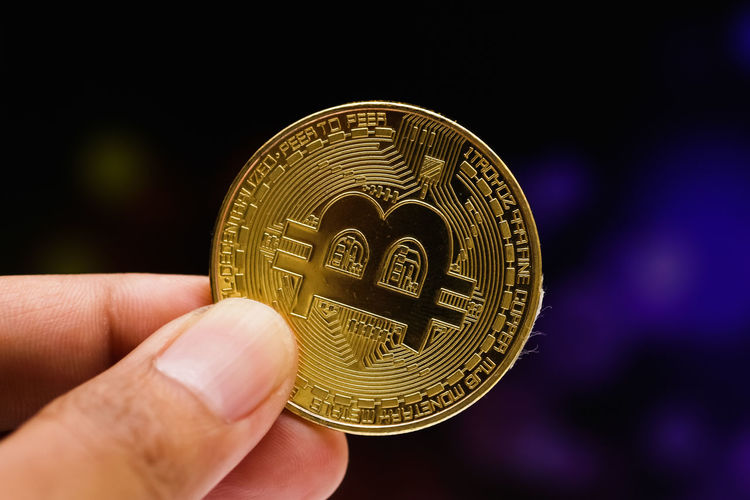 closeup shot of bitcoin BTC Business Currency Economy Gold Golden Background Bank Banking Bitcoin Cash Close-up Coins Commerce Concept Conceptual Crypto Crytocurrency Digital Digital Currency Electronics  Exchange Finance Financial