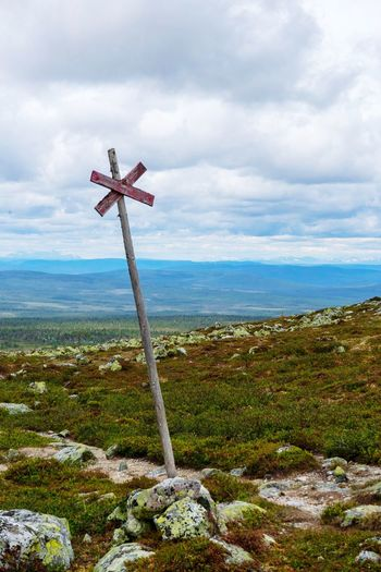 Hiking in Sweden Trailmarker Trail Marker Solitude Mountains Hiking Trail Scandinavia Sweden Outdoor Life Hiking Summer Sky Cloud - Sky Cross Spirituality Religion Belief Nature Beauty In Nature No People Tranquility Tranquil Scene Outdoors