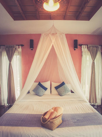 Lover Bali bedroom Bali Bed Bedroom Brown Ceiling Decoration Design Furniture House Indoors  Interior Design Light Living Luxury Mosquito Net Pillow Relaxation Residential Structure Resort Shine Towel Two Villa Vintage Window
