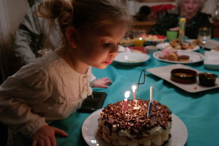 Celebration Headshot Candle Birthday One Person Birthday Candles Birthday Cake Child Indoors  Cake Childhood Table Sweet Food People One Girl Only Time To Celebrate Joyful Moments Candles Light Light Happıness Another Year Older Blowing Candles Birthday Cake Celebration Dessert