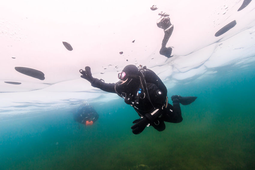 Baikal under Ice Adult Adults Only Adventure Baikal Blackandwhite Cold Dark Day Drysuit Exhilaration Ice Leisure Activity One Man Only One Person Only Men Outdoors People RISK Russia SCUBA Scuba Diving Skydiving Underwater White Winter