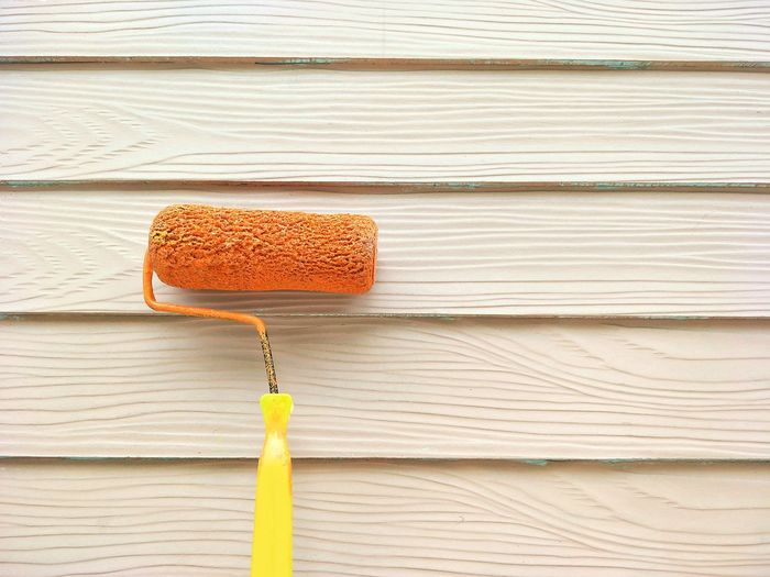 Close up the old roller brush on primer white paint shera wood wall background for painting and renovation concept Painting Shera Wood Wall Yellow Orange Renovation Outside Surface Object Copy Space Job Hobby Decor Pattern Old Primer White Paint EyeEm Selects Backgrounds Textured  Wood - Material Close-up Rough Bark Paint Roller Wood Paneling Brush Knotted Wood Rugged Paintbrush