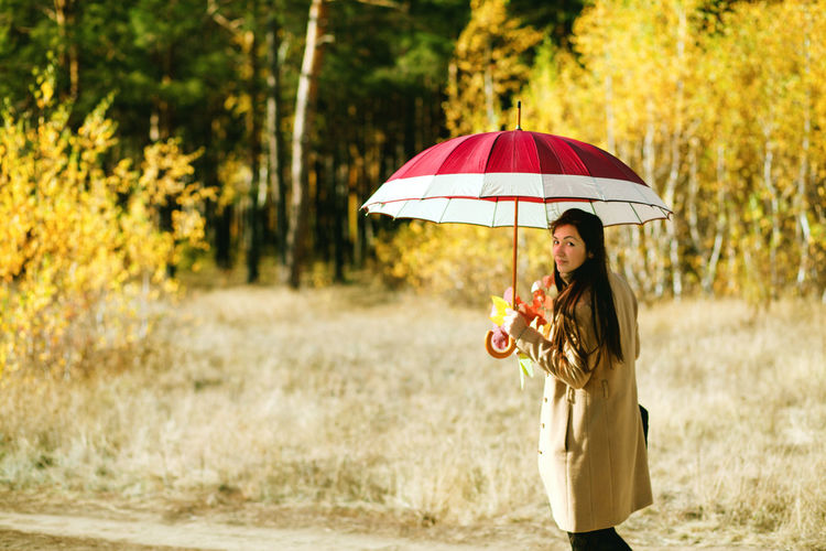 woman walk in autumn forest with umbrella Women Adult Young Adult Standing Outdoors Autumn Forest Leaves Leaves🌿 Umbrella Umbrellas Cold Temperature Gold Colored Females Sexygirl Thoughtful Long Hair Walking Lifestyles Leisure Activity Autumn colors Autumn Leaves autumn mood