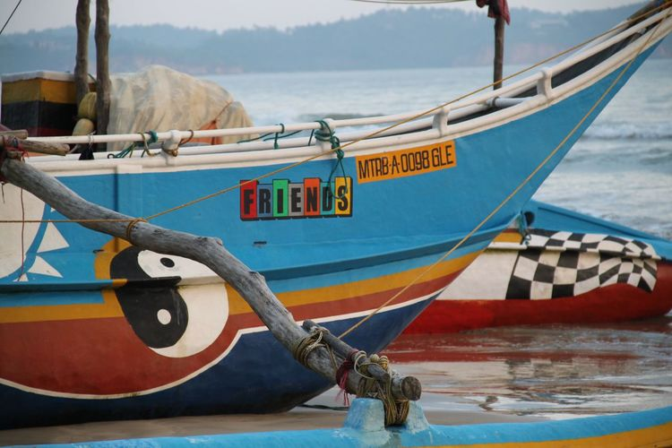 Weligama Boat Details Friends Mode Of Transport Multi Colored Nautical Vessel No People Non-urban Scene Outdoors Sailboat Sea Sri Lanka Transportation Water Yingyang Abstract Colorful The Color Of Business Transportation Moored Mode Of Transportation Text Beach Anchor - Vessel Part