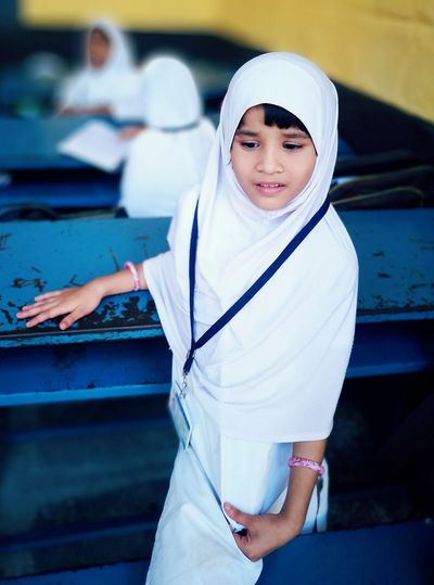 Girl Wearing Hijab While Standing In Classroom