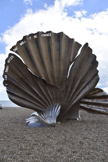 Aldeburgh Scallop Beauty In Nature Blue Close-up Cloud Cloud - Sky Day Design Focus On Foreground Nature No People Outdoors Pebble Beach Sky Suffolk, United Kingdom Sunny Tranquil Scene Tranquility