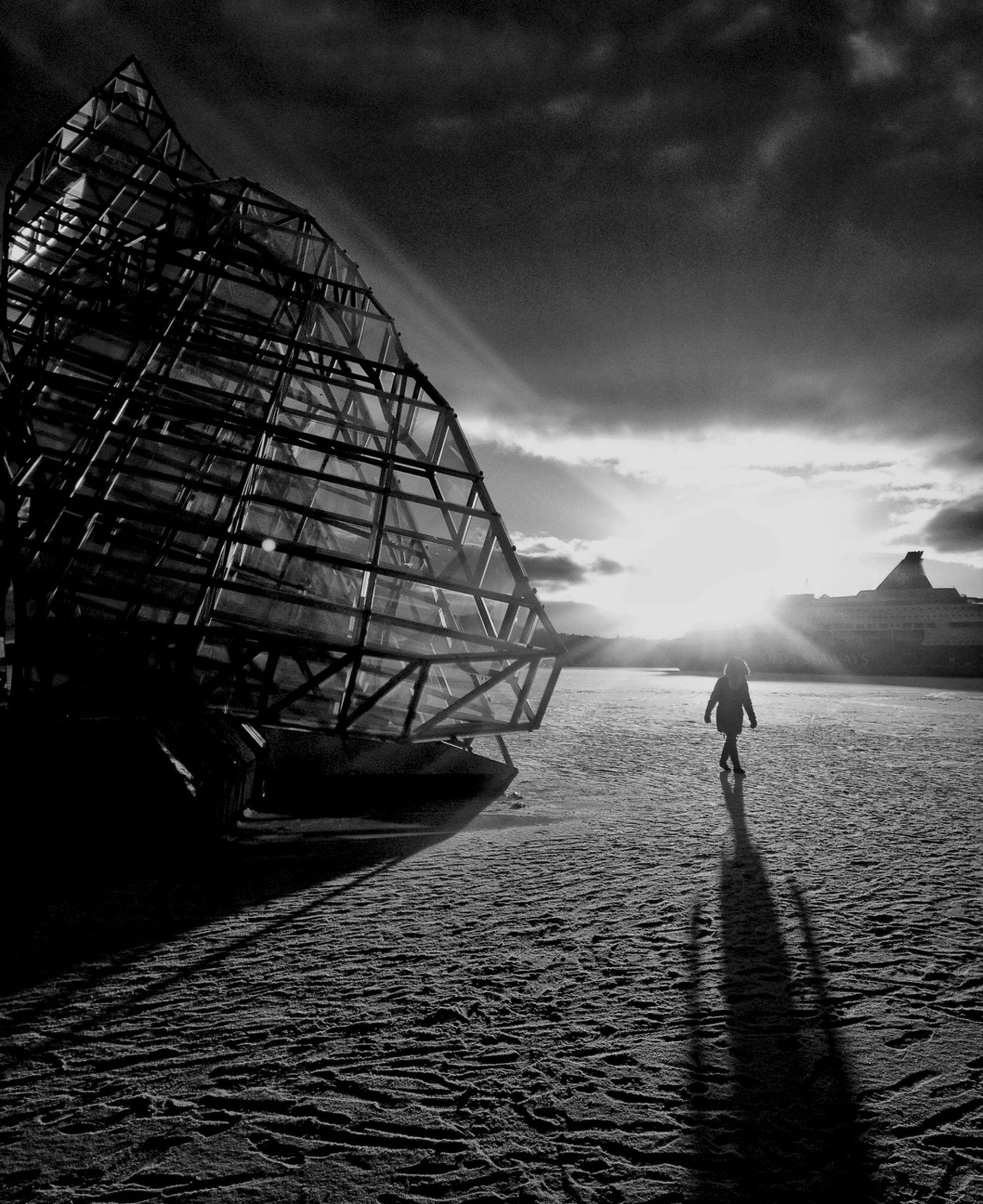 sky, sun, lifestyles, water, leisure activity, cloud - sky, silhouette, sunbeam, full length, sunlight, sea, sunset, men, beach, cloud, walking, lens flare, person
