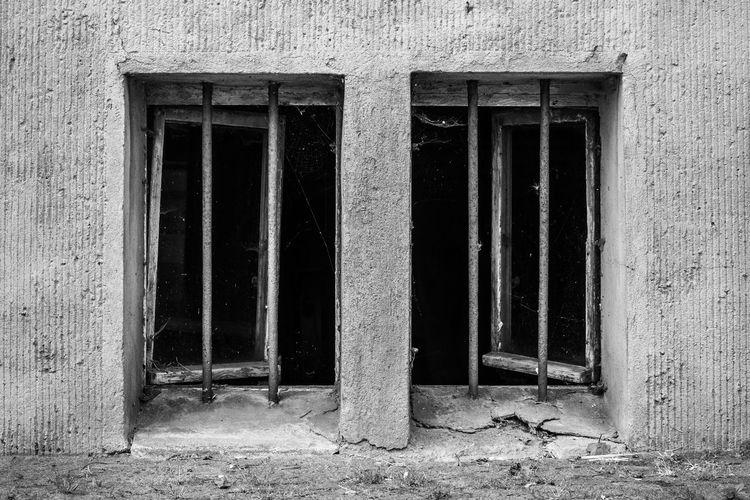 Broken windows on old wall