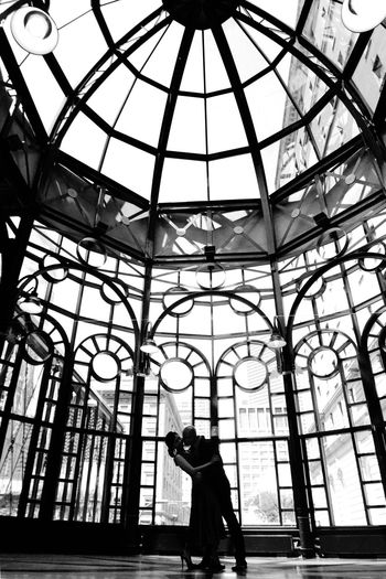 Weddings Around The World Canadian Chinese Wedding in the most historical place where the Canadian Pacific railway office at YYC downtown that will no longer be there after this year. This couple is the last lucky couple to have their Wedding Portrait inside the pavilion. And i am the last lucky photographer who can take pictures there. Fisheye works. Black And White Silhouette The Portraitist - 2016 EyeEm Awards