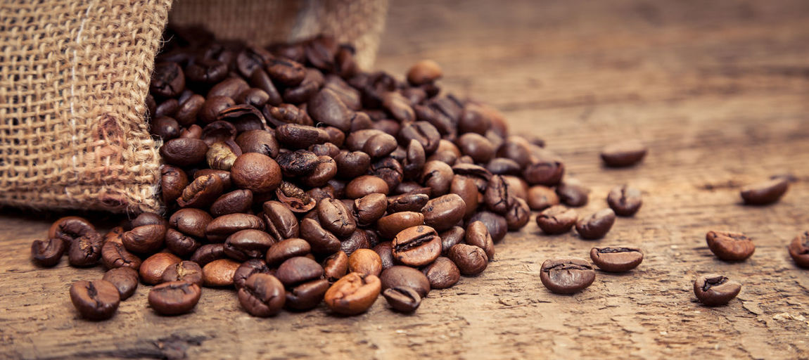 Directly above shot of roasted coffee beans on table