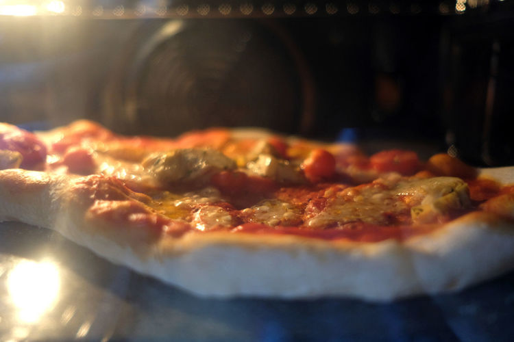 A fresh pizza is baked in a oven Close-up Cooking Cooking At Home Day Food Food And Drink Freshness Freshness FUJIFILM X-T2 Fujifilm_xseries Healthy Eating Healthy Food Healthy Lifestyle Indoors  Italian Food Italy No People Oven Pizza Ready-to-eat Selfmade Food The Week On Eyem