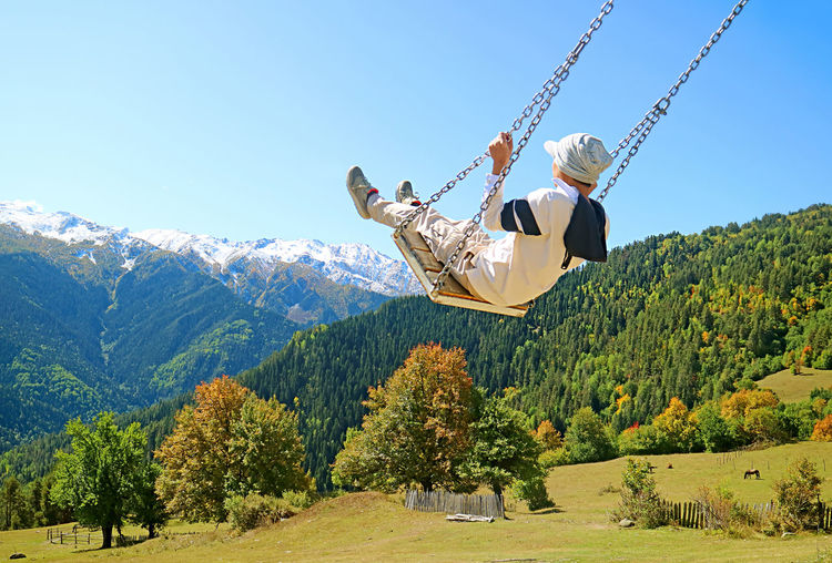 Low angle view of swing against sky