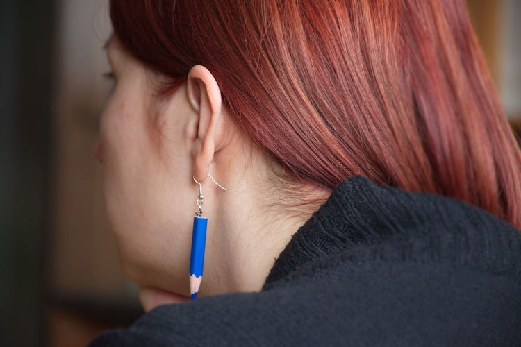 One Person Adult Redhead Indoors  Close-up Hairstyle Real People Lifestyles Headshot Young Adult Hair Portrait Rear View Beautiful Woman Woman Earring  Pencil Ear Red Hair