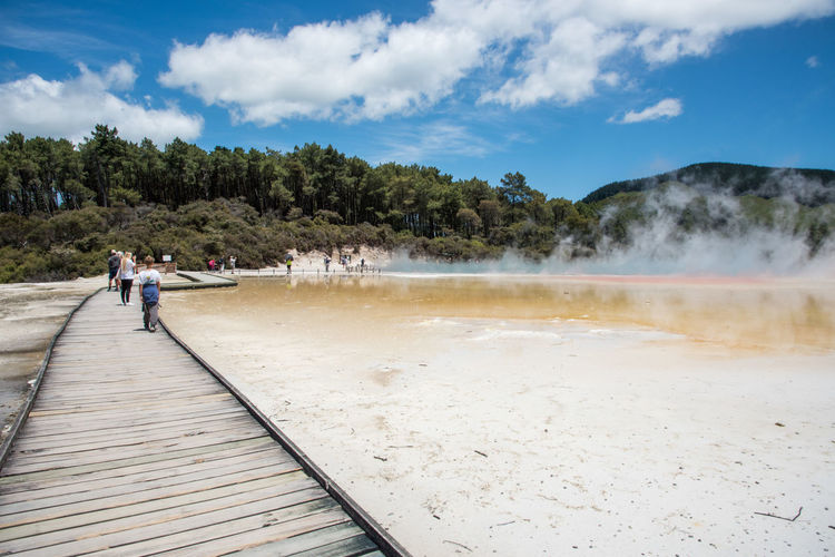 Rotorua,North Island/New Zealand-December 16, 2016: Tourists, boardwalk and Champagne Pool at Wai-o-tapu geothermal area in Rotorua, New Zealand Exploring Footpath Rotorua  Tourist Tourist Attraction  Beauty In Nature Boardwalk Champagne Pool Heat - Temperature Hot Spring Leisure Activity Mountain Nature New Zealand Outdoors Power In Nature Real People Scenics - Nature Steam Tourism Track Travel Volcanic Landscape Walking Water