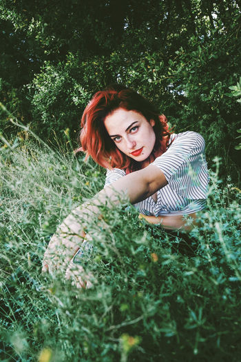 Plant One Person Young Adult Young Women Real People Leisure Activity Portrait Field Looking At Camera Land Nature Lifestyles Growth Women Tree Grass Green Color Casual Clothing Beauty Beautiful Woman Outdoors Hairstyle Dyed Red Hair Contemplation