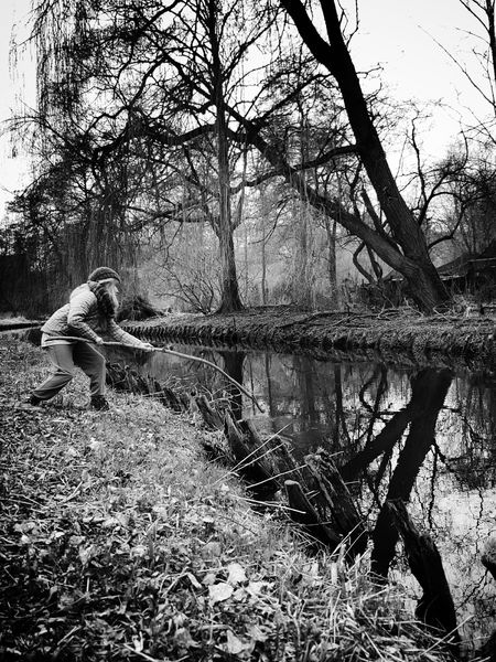 Never too cold to play... Hugging A Tree Playing Outdoors Outdoor Photography Walking Around People Watching Showcase March Blackandwhite Bw_collection From My Point Of View Kids Nature On Your Doorstep Nature River Riverside Water Reflections Wanderlust Fairyland