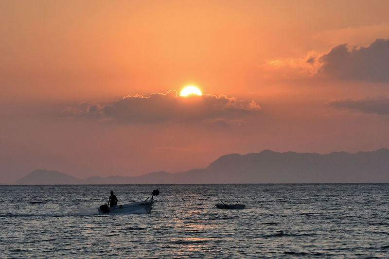 Boats⛵️ Beauty In Nature Idyllic Mode Of Transportation Mountain Nature Orange Color Outdoors Scenics - Nature Sea Silhouette Sky Sun Sunset Transportation Water Waterfront Capture Tomorrow