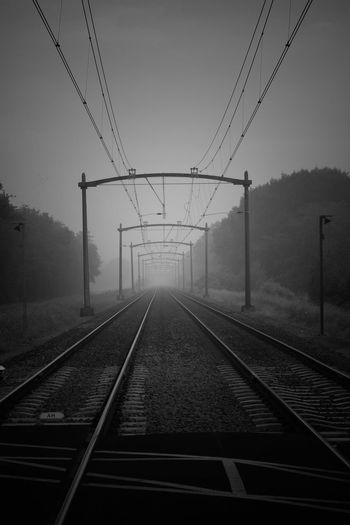 Just Be  Soulsearching Canonphotography Canon 70d Black And White Blackandwhite Photography Working EyeEm Best Shots Light Seeker Electricity Pylon Fog Electricity  Cable Symmetry Railroad Track Parallel Rail Transportation vanishing point Diminishing Perspective The Way Forward
