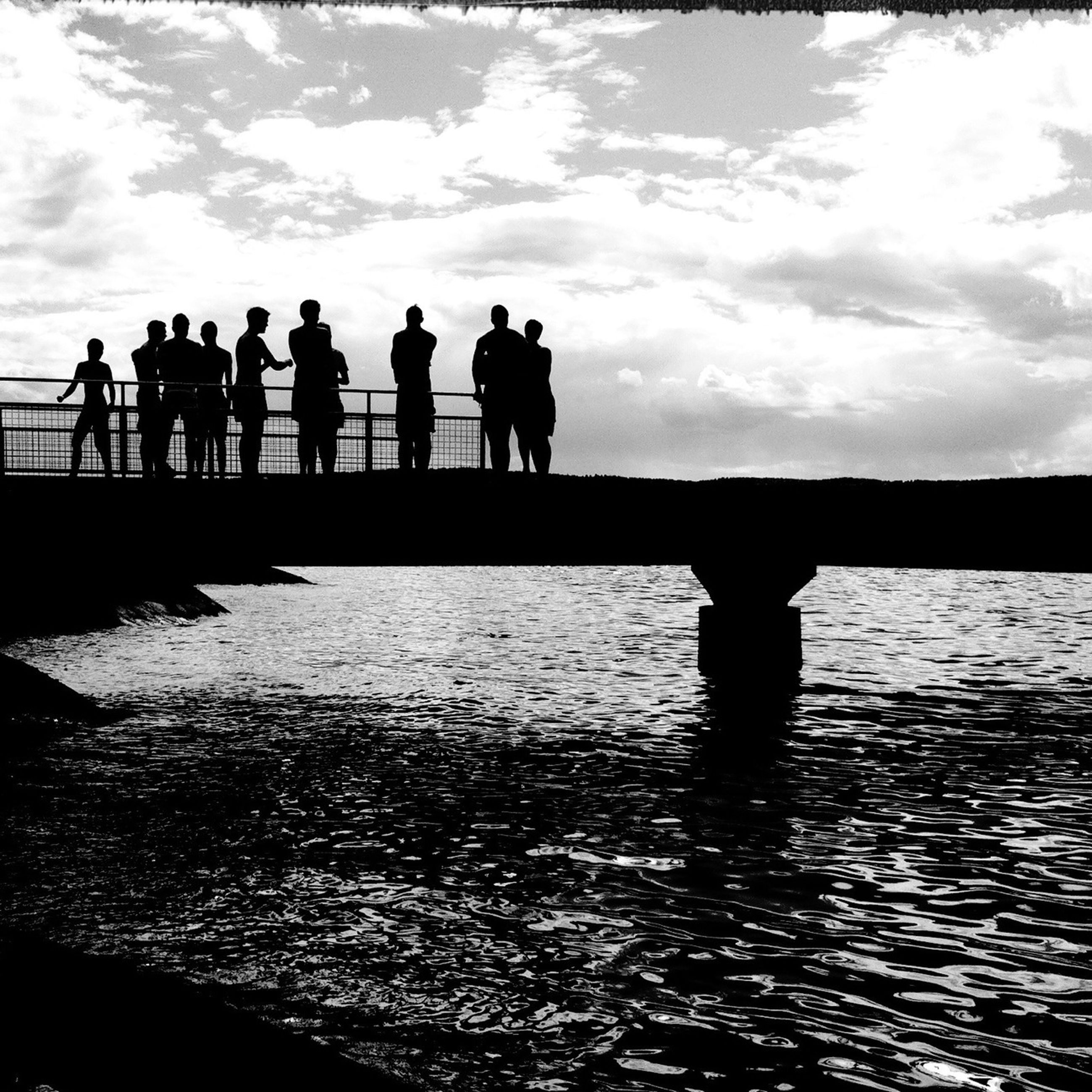 silhouette, water, sky, men, lifestyles, reflection, person, standing, togetherness, leisure activity, walking, cloud - sky, sunset, sea, full length, nature, waterfront, medium group of people