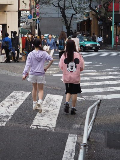 City Fashion Girls Japanese  Leisure Activity Leisure Time Lifestyles Mickey Mouse Real People Rear View Street The Way Forward Togetherness Tokyo Two People Walking Women Young Adult Women Around The World