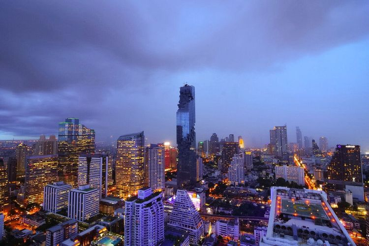 Cityscape Tower Cloud - Sky Tall - High Weather Wet Day Strom City Lights Architecture Built Structure City Building Exterior Skyscraper Illuminated Sky Urban Skyline Modern Building Story Office Building Growth City Life Wide Development Mahanakhon mahanakhon bangkok