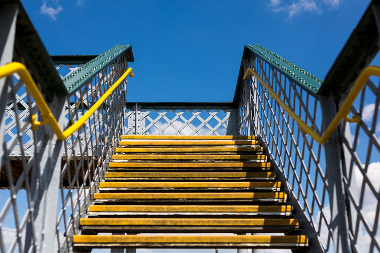 Low angle view of yellow staircase against sky