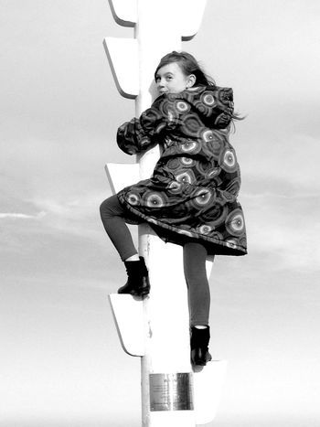 Black And White Photography Black And White MonochromePhotography Monochrome Intrepid Girl Climbing a Lookout Pole