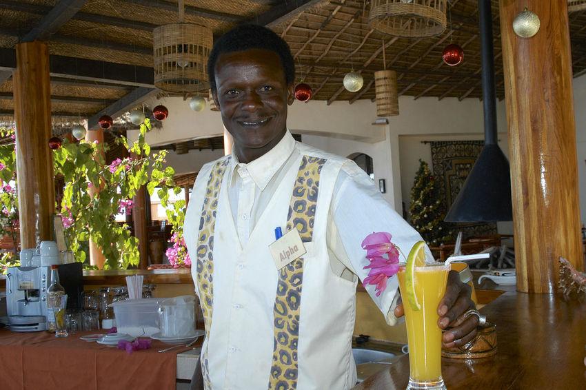 Having a drink in Palmarin Senegal Cocktail Drinks Palmarin Bartender Cheerful Cocktails Glass Looking At Camera One Person Portrait Senegal Sine Saloum Delta Sine-saloum Delta Smiling
