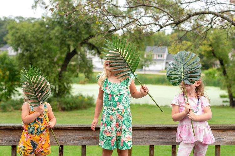 Full length of girl and plants against trees