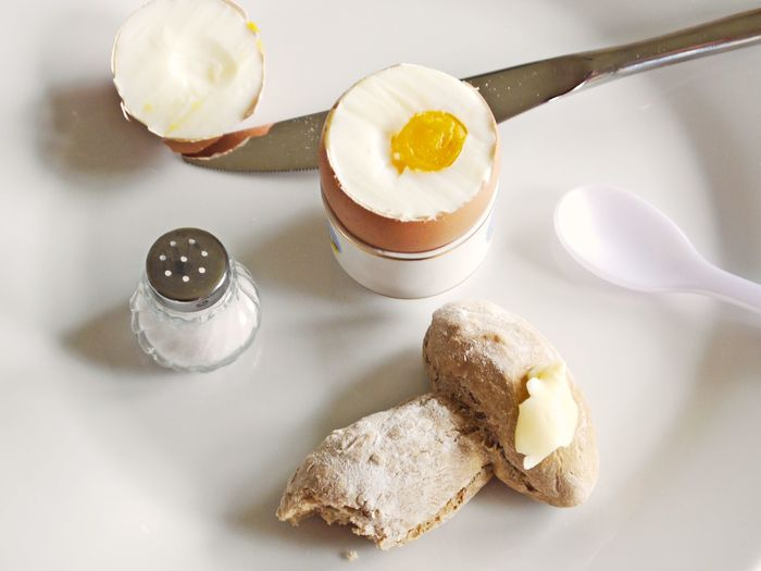 Bread Butter Close-up Dairy Product Day Egg Yolk Eggshell Food Food And Drink Freshness Gourmet Healthy Eating High Angle View Indoors  Knife No People Ready-to-eat Roasted Bread Salt Shaker Spoon Table