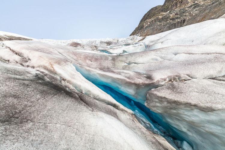 Crevasse on haugabreen glacier against clear sky