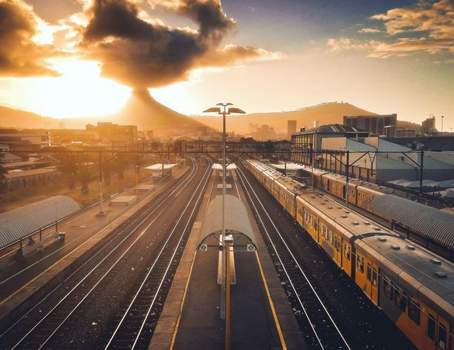 High angle view of railway tracks against sky at sunset