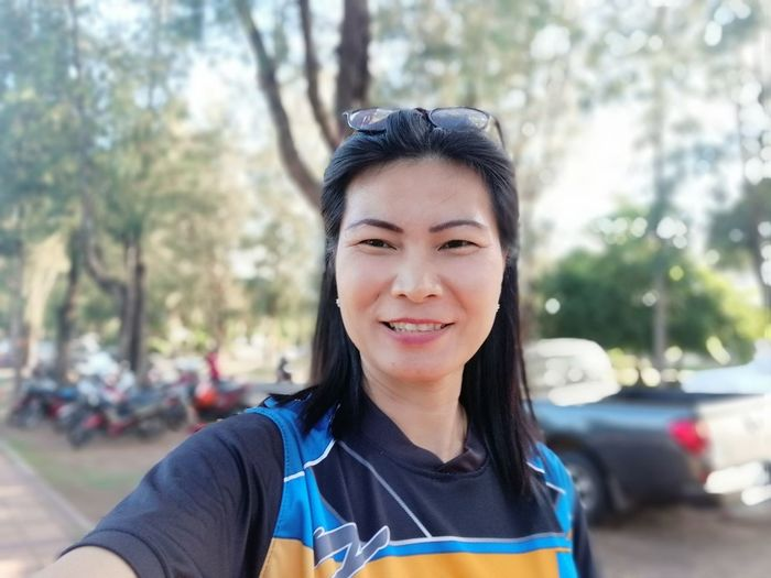 Close-up portrait of smiling woman in park