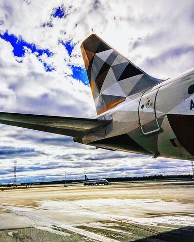 Etihadairways Airbus A320 Cloud - Sky Airplane Sky No People Day Airport Airport Runway Air Vehicle Outdoors Vertical Airshow Aerospace Industry Fighter Plane Air Force