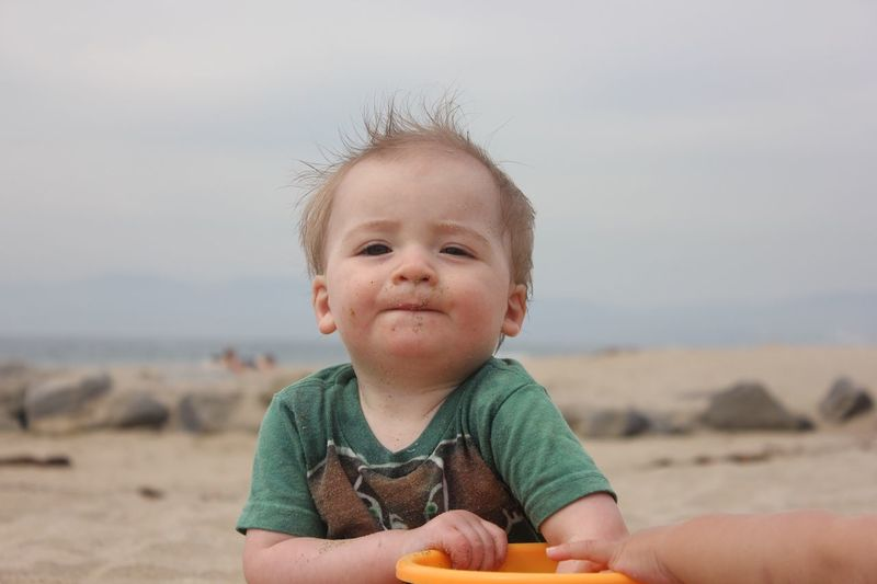 Baby concentrating as he plays with sand EyeEm Selects Real People Childhood Sand One Person Cute Baby Focus On Foreground Beach Day Outdoors Looking At Camera Leisure Activity Lifestyles Portrait Sky Happiness Close-up Nature People California Dreamin