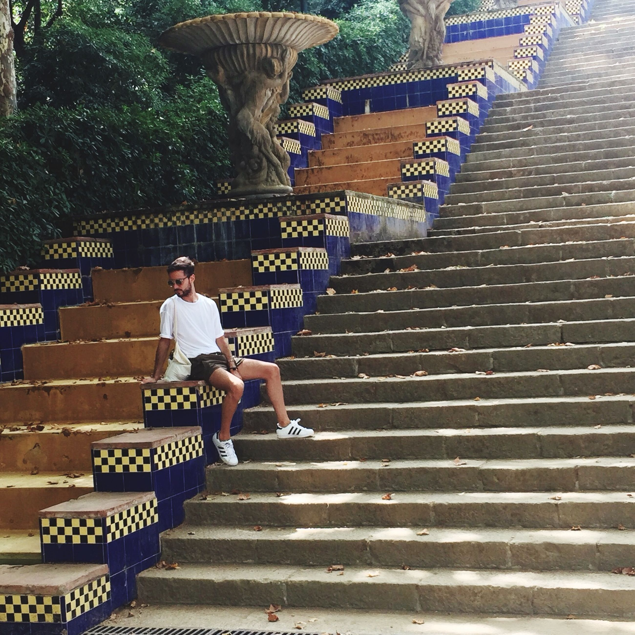 steps, lifestyles, full length, leisure activity, built structure, steps and staircases, casual clothing, building exterior, architecture, staircase, rear view, walking, the way forward, railing, outdoors, sunlight, standing, day