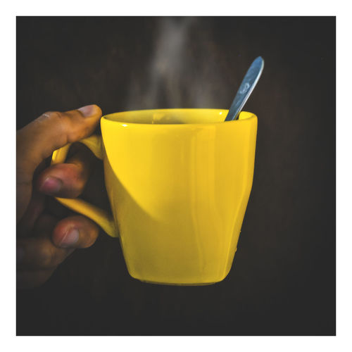 Close-up Day Drink Food And Drink Freshness Fruit Healthy Eating Holding Human Body Part Human Hand Indoors  One Person People Real People Studio Shot Yellow