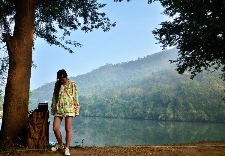 Full length of girl standing at lakeshore
